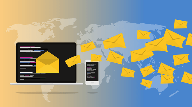 A graphic of envelopes flying form a desktop screen and a mobile phone